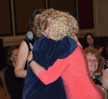 Dr. Sandi Radomski, ACEP Award speaker embraces recipient, Dr. Patricia Carrington at 2015 ACEP Virginia ceremony.