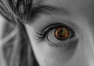 War zone reflected in a child's eye