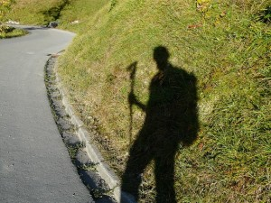 shadow of traveling man with walking stick